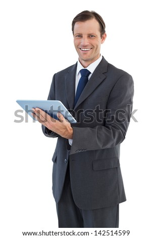 Smiling businessman holding a tablet computer on white background - stock photo