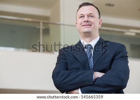 Smiling businessman in a suit and tie