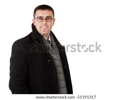 smiling businessman in autumn coat, white background - stock photo