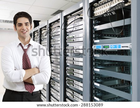 Smiling businessman in server room