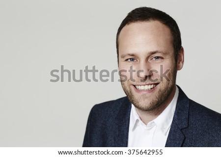 Smiling businessman in studio - stock photo