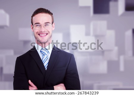 Smiling businessman in suit with arms crossed against abstract white room - stock photo