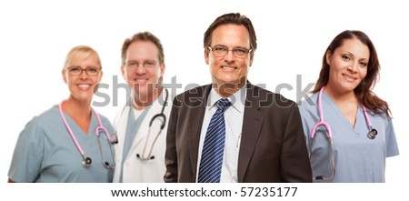 Smiling Businessman in Suite and Tie While Male and Female Doctors and Nurses Stand Behind Isolated on a White Background. - stock photo