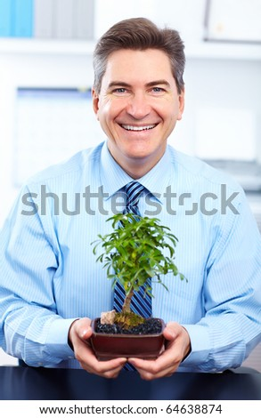 Smiling  businessman  in the office - stock photo