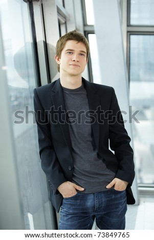 smiling businessman in the office building - stock photo