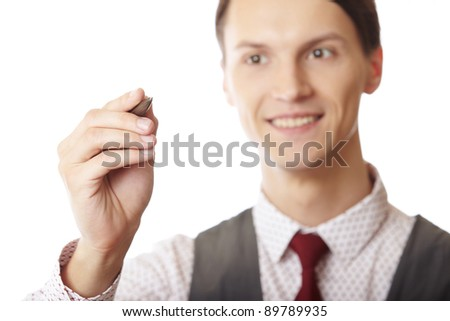Smiling businessman is writing on a virtual whiteboard. Focus is on the hand and pen