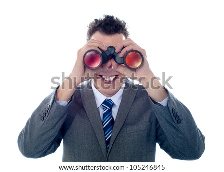 Smiling businessman looks through binoculars and seeks success. All on white background - stock photo