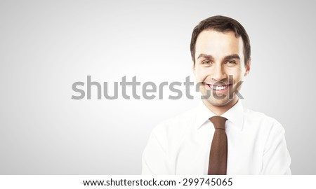 smiling businessman on white background - stock photo