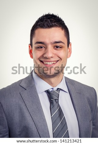 Smiling businessman portrait, tinted photo