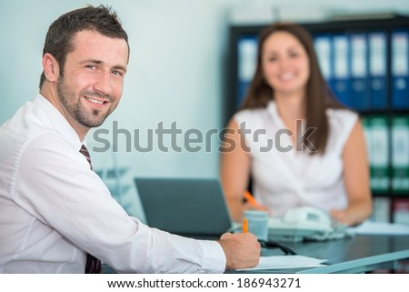 Smiling businessman posing in office