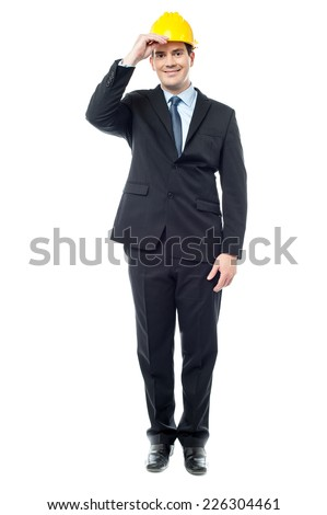 Smiling businessman posing with construction helmet - stock photo