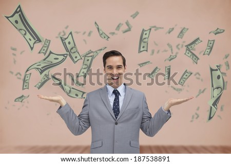 Smiling businessman presenting dollars with his hands against room with wooden floor