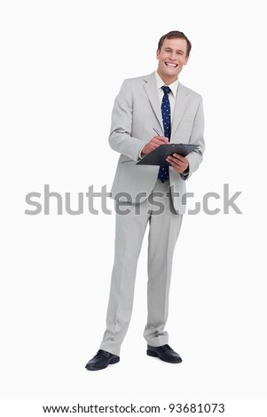 Smiling businessman ready to take notes against a white background