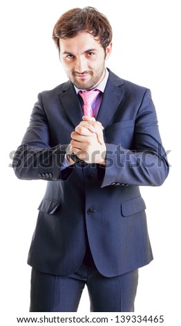 Smiling businessman rubbing his hands isolated on white - stock photo
