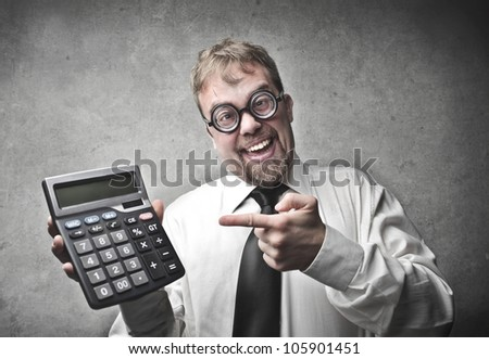 Smiling businessman showing a calculator - stock photo