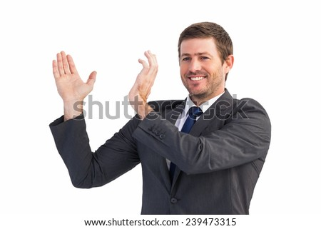 Smiling businessman showing something with his hands on white background