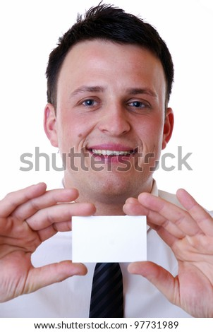 smiling businessman shows an empty business card