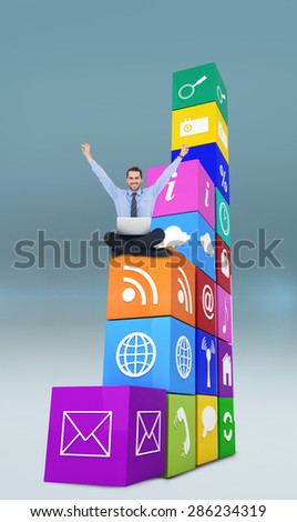 Smiling businessman sitting on the floor cheering against blue vignette background