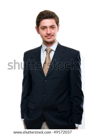 Smiling businessman standing against isolated white background - stock photo