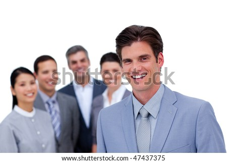 Smiling businessman standing in front of his team against a white background