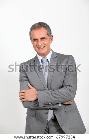 Smiling businessman standing on white background