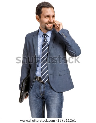 Smiling businessman talking on the phone  isolated over white background  - stock photo