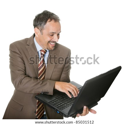 Smiling businessman using a laptop on white background - stock photo