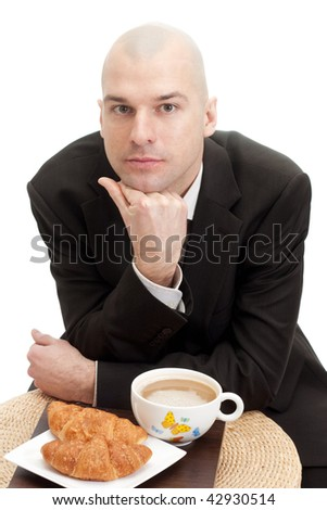 Smiling businessman with a cup, isolated over white background