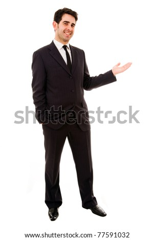 Smiling businessman with arm out in a welcoming gesture , isolated on white background