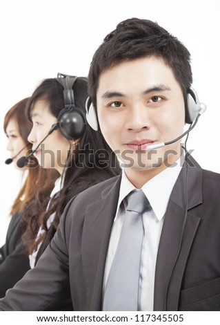smiling  businessman with call center agent - stock photo