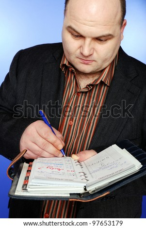 smiling businessman with daily planner - stock photo
