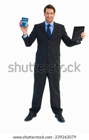 Smiling businessman with digital tablet and calculator on white background - stock photo