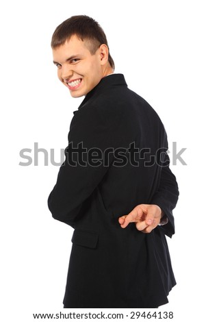 Smiling businessman with fingers crossed behind his back - stock photo