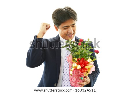 Smiling businessman with flowers