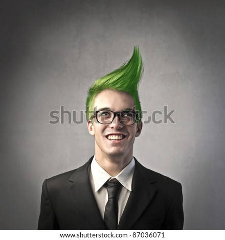Smiling businessman with green upright hairstyle - stock photo