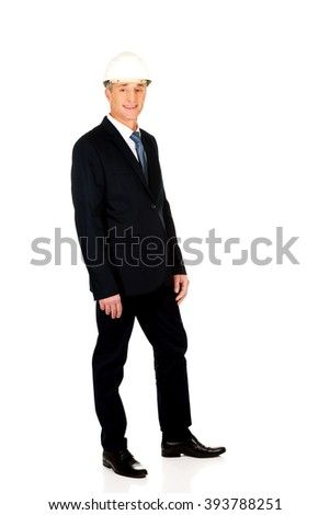 Smiling businessman with hard hat