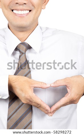 smiling businessman with heart made from hands - stock photo