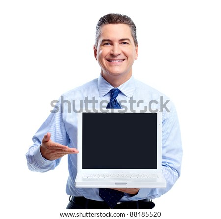 Smiling businessman with laptop computer. Isolated over white background.
