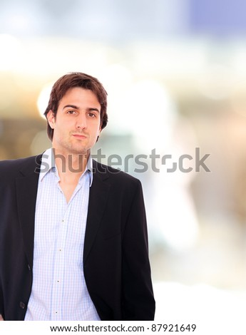Smiling businessman  with light business background - stock photo