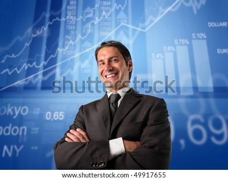 Smiling businessman with schemes and statistics on the background - stock photo