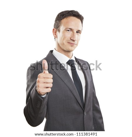 Smiling businessman with thumb up - stock photo