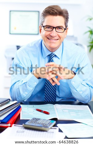 Smiling  businessman working in the office - stock photo