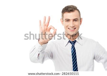 Smiling businessmen showing ok sign - stock photo