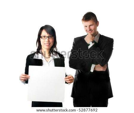 Smiling businesswoman and businessman looking at camera with blank sign on white background