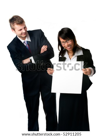 Smiling businesswoman and businessman with blank sign. Write something on blank sign.