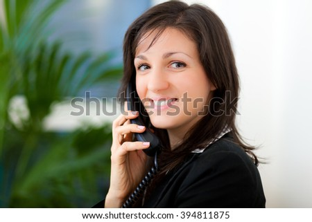 Smiling businesswoman at the phone - stock photo
