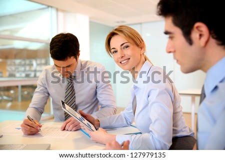 Smiling businesswoman attending meeting - stock photo