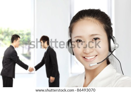 Smiling businesswoman  customer service on the phone - stock photo