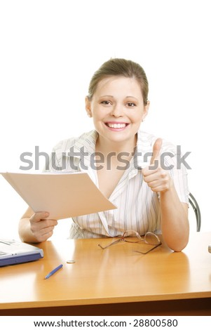 Smiling businesswoman gesturing thumb up holding pile of paper
