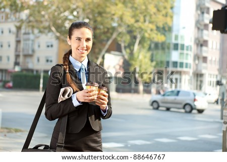 smiling businesswoman going to work in morning , outdoor - stock photo